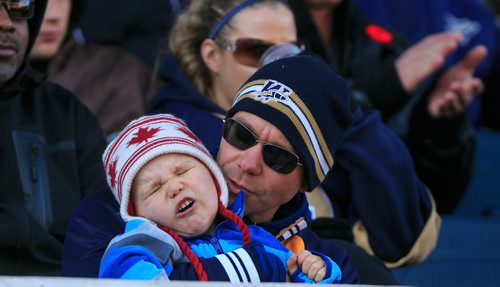 Keith Tarr calms his three-year-old son Jaxon near the end of another Blue Bombers loss at Investors Group Field. Winnipeg Blue Bombers lost the final game of the season against the Hamilton Tiger Cats on Saturday. 131023 - Wednesday, October 23, 2013 - (Melissa Tait / Winnipeg Free Press)