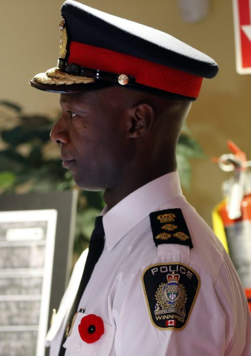 Wpg Police CHief Devon Clunis - Wpg Police Chief Devon Clunis  gets congrats by Premier Greg Selinger , and Sam Katz  at the Ma Mawi Wi Chi Itata Centre  of the Urban Circle Training Centre. The Province of Mb , City of Wpg launch a 3 year  21 block radius crime , $600,000 prevention initiative , providing police at support for the neighborhood .  Nov. 6 2013 / KEN GIGLIOTTI / WINNIPEG FREE PRESS