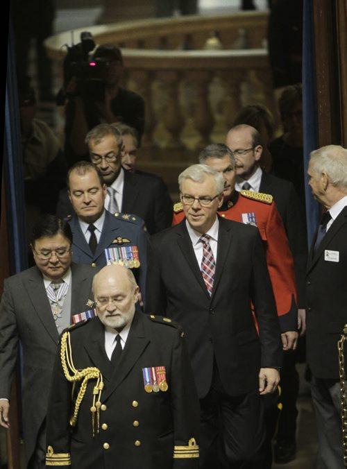 In centre, Manitoba Premier Greg Selinger at right and Lt.-Gov. Philip Lee enter the Manitoba Legislature Tuesday afternoon for the Speech from the Throne. Dan Lett/Bruce Owen/Larry Kusch  Wayne Glowacki / Winnipeg Free Press Nov. 12. 2013