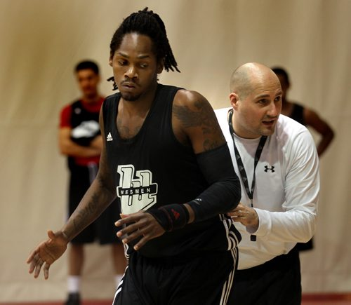 Wesmen Basketball coach Mike Raimbault pulls Steven Wesley through a practice play Tuesday afternoon at the Duckworth Center. See Tim Campbell's story. November 19, 2013 - (Phil Hossack / Winnipeg Free Press)