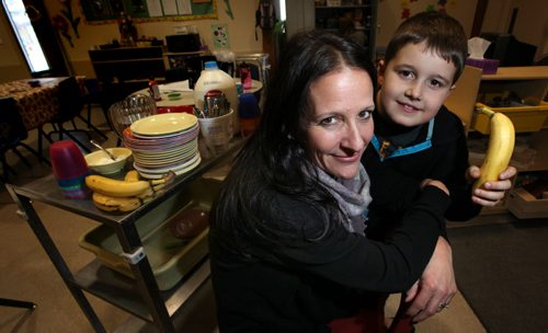 Robyn Avery and her seven-year-old son, Nathan.¤Robyn's daycare has a hot lunch program that focuses on good nutrition. While Robyn doesn't necessarily agree with everything in the Food Guide, her daycare follows it when preparing meals and snacks. She uses common sense to ensure her daycare kids--and her own family--get their share of healthy, less refined foods.¤ Shamona Harnett story. November 28, 2013 - (Phil Hossack / Winnipeg Free Press)