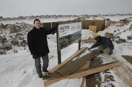 Finance.  Spencer Curtis with Hilton Custom Homes at the Bridgwater Town Centre development site by one of the first of 120 single-attached homes to be built.    Murray McNeill  story. Wayne Glowacki / Winnipeg Free Press Nov. 28. 2013