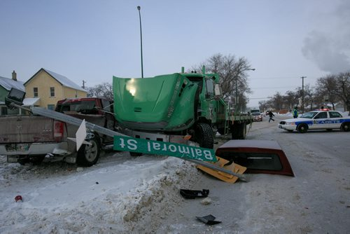 A semi and a pick up truck crashed at Balmoral and Cumberland late Tuesday morning. Three other cars were involved in the crash. One person was reportedly sent to hospital with minor injuries. (Cumberland was closed as of 11am.)  131210 - Tuesday, December 10, 2013 - (Melissa Tait / Winnipeg Free Press)