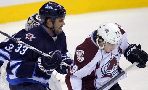 #33 Jets Dustin Byfuglien whacks Colarado #29 Nathan MacKinnon. Winnipeg Jets against the Colorado Avalanche. BORIS MINKEVICH / WINNIPEG FREE PRESS  December 12, 2013