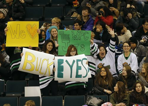 Stdup Jets , Miles Macdonell  teacher Pam Okano  ( waving )brought a group of international students to the practice  wave Miles Mac Buckeyes  posters at the jets Practice  Jets Practice  at MTS Centre in front of 1700 fans , school groups were bussed to the practice to watch the team-  Dec. 13 2013 / KEN GIGLIOTTI / WINNIPEG FREE PRESS