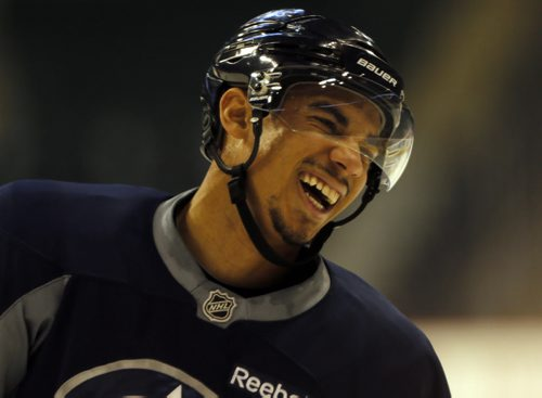 Happy to be back- An injured Evander Kane returned to the ice to practice with the team , it seemed he was taking every second shift with his linemates . Jets Practice  at MTS Centre in front of 1700 fans , school groups were bussed to the practice to watch the team-  Dec. 13 2013 / KEN GIGLIOTTI / WINNIPEG FREE PRESS
