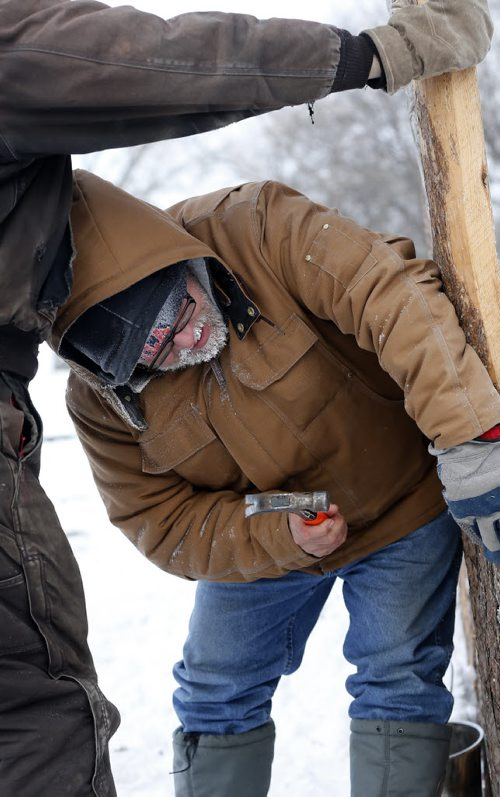STDUP - Voyageur weather at -30 – hardy voyageurs  like Luke Goveil began the first of  site preparations for the up coming winter festival . A work crew was busy putting up fence  s along entrance to Festival park  JAN. 6 2014 / KEN GIGLIOTTI / WINNIPEG FREE PRESS