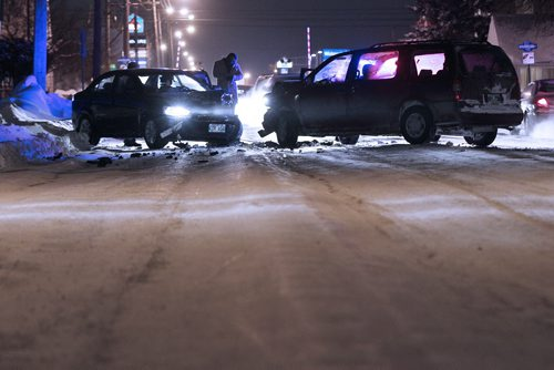 January 6, 2014 - 140106  -  Cars collide on Ellice Avenue after sliding on the icy rut filled road Monday, January 6, 2014. John Woods / Winnipeg Free Press