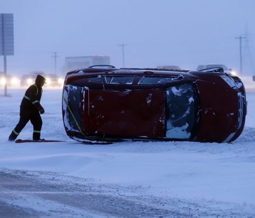 Emergency crews were called to a single vehicle rollover the west bound North Perimeter between Pipeline Rd. and Brookside Blvd ,in high winds , blowing snow and icy road conditions exist outside the city -  JAN. 9 2014 / KEN GIGLIOTTI / WINNIPEG FREE PRESS