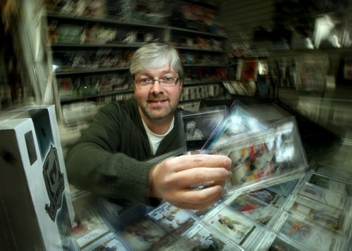 This week's Money Matters looks at the financial side of collecting hockey cards. It's not just old cards that fetch a pretty penny these days. There's a new generation of high-end collectors' cards that are worth more than $100 a pack, and if you're lucky enough to find a would-be superstar rookie among the five or so cards in the pack, you could be holding in your hand a collectable worth thousands. Kyle Franklin, owner of Superstar Sports shows off some examples of the new premium cards. See story. January 21, 2014 - (Phil Hossack / Winnipeg Free Press)