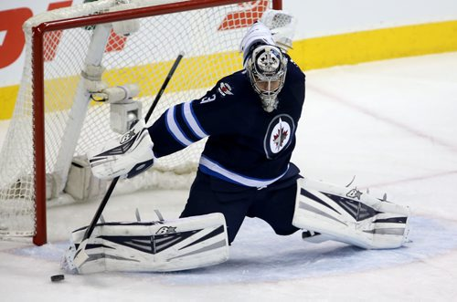 Winnipeg Jets' goaltender Ondrej Pavelec (31) makes a first period save against the Toronto Maple Leafs' during first period NHL hockey action at MTS Centre in Winnipeg, Saturday, January 25, 2014. (TREVOR HAGAN/WINNIPEG FREE PRESS)
