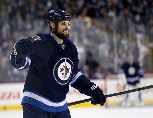 Winnipeg Jets' Zach Bogosian (44) celebrates after he scored against the Toronto Maple Leafs' during second period NHL hockey action at MTS Centre in Winnipeg, Saturday, January 25, 2014. (TREVOR HAGAN/WINNIPEG FREE PRESS)