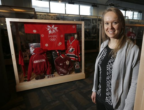 Olympic speed skater Cindy Klassen   with Women's Olympic Hockey display in background -Klassen's 2006 Torino Bronze medal is part of the speed skating exhibit  Cindy Klassen opens Manitoba  Sports Hall of Fame  Olympic Exhibit  , with a exhibits by Klassen and Clara Hughes ,men and women's Olympic hockey , Jon Montgomery 's sled and articles going all the way back to the  1930's  Lake Placid Games  hockey memorabilia , Wpg Falcons 1920  - ed tait  JAN. 29 2014 / KEN GIGLIOTTI / WINNIPEG FREE PRESS