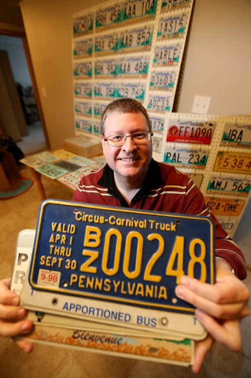 Manny Jacob, a member of the ALPCA, an international association of license plate collectors, and part of his collection, Friday, February 14, 2014. (TREVOR HAGAN/WINNIPEG FREE PRESS) - for 49.8 intersection dave sanderson piece.