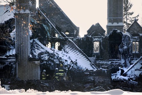 February 17, 2014 - 140217  -  Fire investigators work at the fire scene at 1021 Wellington Crescent Monday, February 17, 2014. John Woods / Winnipeg Free Press