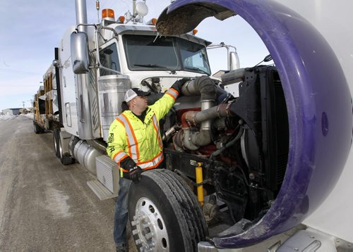 Trucker Kelly Ring checks his rig in Winnipeg Wednesday before hauling building supplies to the Garden Hill First Nation. For Alex Paul story on Winter Roads.  Wayne Glowacki / Winnipeg Free Press Feb. 19   2014