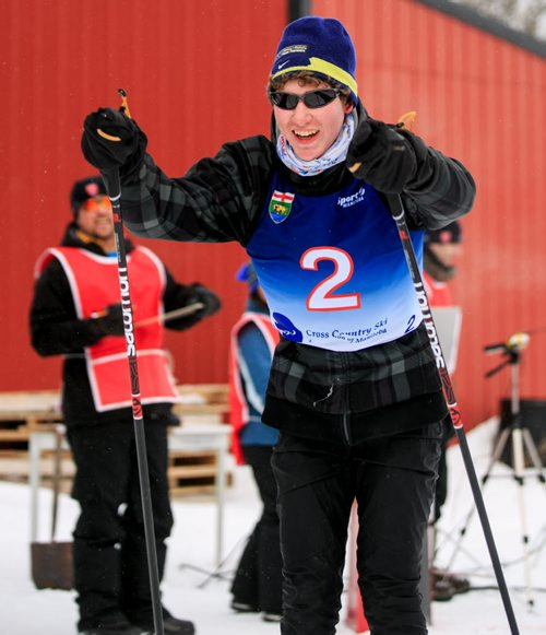 Jesse Bachinsky, 15, smiles as he crosses the finish line of the 7.5km male juvenile cross country ski race, as part of the 2014 Power Smart Manitoba Winter Games at Birch Ski Area in Roseisle, MB. Bachinsky is thought to be the first ever visually impaired athlete to compete in cross country skiing at the Manitoba Games. 140303 - Monday, {month name} 03, 2014 - (Melissa Tait / Winnipeg Free Press)