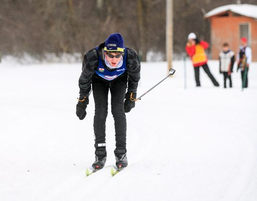 Jesse Bachinsky, 15, pushes to the finish line of the 7.5km male juvenile cross country ski race, as part of the 2014 Power Smart Manitoba Winter Games at Birch Ski Area in Roseisle, MB. Bachinsky is thought to be the first ever visually impaired athlete to compete in cross country skiing at the Manitoba Games. 140303 - Monday, {month name} 03, 2014 - (Melissa Tait / Winnipeg Free Press)