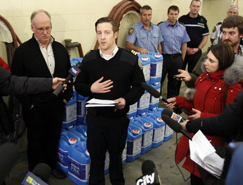 Update on City services relating to frozen water pipes. Winnipeg Fire Paramedic Service preparing water jugs for delivery at Winnipeg Fire and Paramedic Station 22, 1567 Waverley Street. left, Randy Hull, Emergency Preparedness Coordinator and centre, Tom Wallace, Acting Assistant Chief, Operations, Winnipeg Fire and Paramedic Service at the presser. BORIS MINKEVICH / WINNIPEG FREE PRESS  March 7, 2014