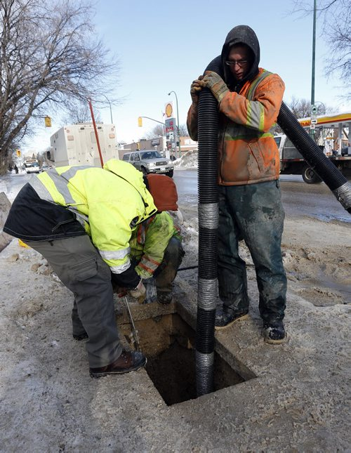 City Infrastructure story –in pic city and contract workers prepare ground  for heating  frozen water pipes  on Mountain Ave  at Salter for homes without water   - Mar. 10 2014 / KEN GIGLIOTTI / WINNIPEG FREE PRESS