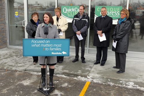 QUICKCARE CLINICS - Initiatives to help ensure all Manitobans have access to a family doctor by 2015 and location of a new QuickCare Clinic. In front of future clinic. Health Minister Erin Selby addresses the media. BORIS MINKEVICH / WINNIPEG FREE PRESS  March 11, 2014