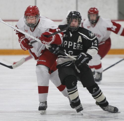 At right,  Dauphin Clippers player Theron Ash and  Kelvin Clippers player Sam Narvey chase the puck during their AAAA Provincial Tournament semi-final game at the Gateway Recreation Centre Friday. The Kelvin Clippers  defeated the Dauphin Clippers 6-1.   Wayne Glowacki / Winnipeg Free Press March 14   2014
