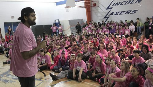 Obby Khan, former Winnipeg Blue Bomber player spoke of his experiences of bullying to students at Lincoln Middle School  wearing their pink T shirts at the Canadian Red Cross Day of Pink celebration held at their school Wednesday. The event included words from  James Allum, Education and Advanced Learning Minister and anti-bulling videos produced by the students were also shown. The students and staff were among the over 19,000 people across the province standing for respect wearing pink T-shirts. In Manitoba more than 365 schools and businesses are hosting events that include film festivals, speakers' series, rallies, and parades to inspire others to recognize and respond to bulling.     see release. Wayne Glowacki / Winnipeg Free Press April 9   2014