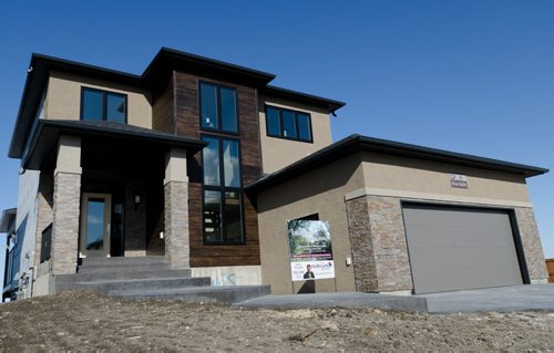 Exterior of 8 Stan Bailie Drive in South Pointe.  EMILY CUMMING / WINNIPEG FREE PRESS APRIL 14, 2014