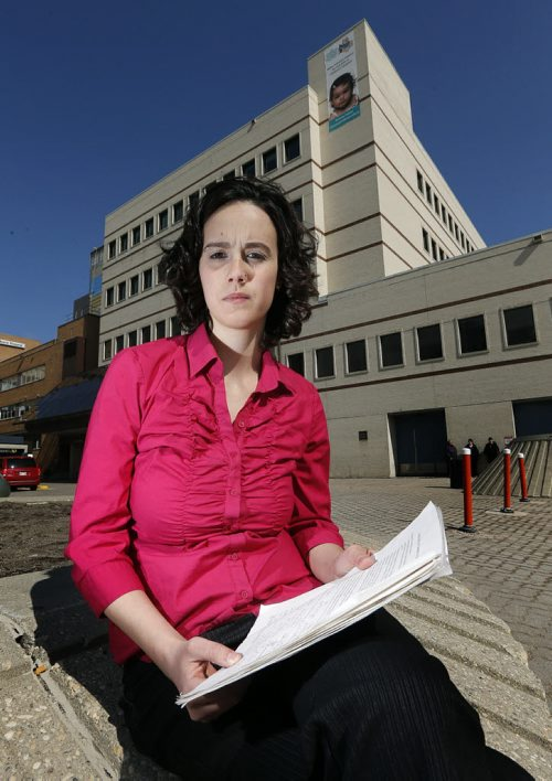 Dr. Megan Cooney outside Children's Hospital with a petition :  Dr. Megan Cooney  with a petition that she and a group of pediatric resident doctors at the Children's Hospital have started to encourage provincial government legislation to to prohibit minors from using artificial  tanning equipment (tanning beds) a way to protect youth from known dangers of tanning beds, most notably skin cancer. -for Ashley Prest  story, running Wednesday.  APRIL 22 2014 / KEN GIGLIOTTI / WINNIPEG FREE PRESS