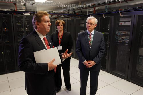 The new Canadian Tire Cloud Computing Centre in Winnipeg, Manitoba. One of the most advanced centres of its kind in North America, the tour will showcase the 28,000 square foot site, which houses a digital content warehouse, application lab, testing lab and high performance data centre. It will serve as the core digital hub for the Canadian Tire Family of Companies.Canadian Tire's Eugene Roman explains some features of the new tech centre to Hon. Theresa Oswald Seine River,  Minister of Jobs and the Economy, and Premier Greg Selinger.  BORIS MINKEVICH / WINNIPEG FREE PRESS April 22, 2014