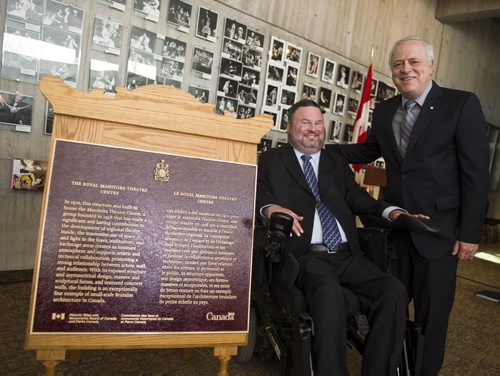 140426 Winnipeg - DAVID LIPNOWSKI / WINNIPEG FREE PRESS (April 26, 2014)  The Honourable Steven Fletcher (left) and the Artistic Director of the Royal Manitoba Theatre Centre Steven Schipper, pose with a plaque commemorating the Royal Manitoba Theatre Centre's MainStage building as a national historic sit of Canada. The theatre is Canada's oldest English-speaking regional theatre and is an example of small-scale Brutalist architecture in Canada.