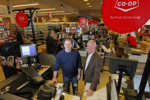 Co-op food store being set up where the Safeway in Southdale was. Store manager Paul Jackson and regional Co-op manager Doug Wiebe pose for a photo in the store. BORIS MINKEVICH / WINNIPEG FREE PRESS  May 14, 2014