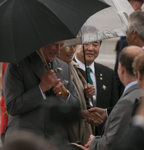 Prince Charles and Camilla, Duchess of Cornwall, arrive on the wet and windy tarmac at CFB Winnipeg Tuesday evening. The royal couple will visit Winnipeg for 27 hours. 140520 - Tuesday, May 20, 2014 - (Melissa Tait / Winnipeg Free Press)