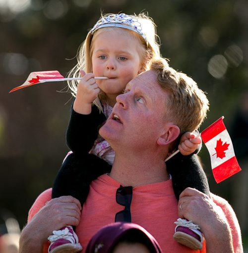 Kiri MacAulay, 3, waits patiently for the arrival of the Prince atop her dad Scott's shoulders at the Legislature Wednesday evening. More than 1000 people cheered for Prince Charles and Camilla, Duchess of Cornwall, as they made their final stop at the Legislature on a whirlwind 27-hour royal tour visit to Winnipeg. 140521 - Wednesday, May 21, 2014 - (Melissa Tait / Winnipeg Free Press)