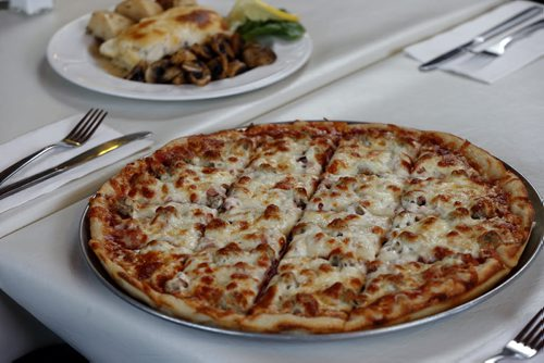 June 3 2014 / KEN GIGLIOTTI / WINNIPEG FREE PRESS  ENT - restaurant review – Juliana Pizza  – with co owner Marrian Polsom  meatlovers pizza , June 3 2014 / KEN GIGLIOTTI / WINNIPEG FREE PRESS