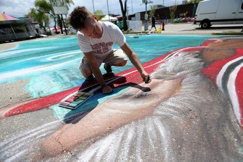 Local artist Charlie Johnston, working on a 4000sq foot chalk drawing at the Hi Neighbour Festival in Transcona, Sunday, June 8, 2014. (TREVOR HAGAN/WINNIPEG FREE PRESS)