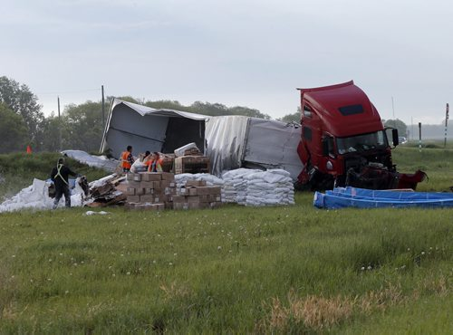 A semi wreaked  on the Perimeter Hwy. near Hwy 3 sending a load of flour  , computer equipment and canoes all over the ditch . The driver had minor injuries. The  truck and load is completely off the road and cleanup crews and tow trucks are on scene . The incident occurred around 1am Monday morning .  June 9 2014 / KEN GIGLIOTTI / WINNIPEG FREE PRESS