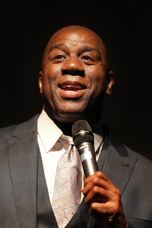 "Earvin ""Magic"" Johnson flashes his ""magic megawatt smile""  at the Rady Center annual dinner Thursday. See story. June 19, 2014 - (Phil Hossack / Winnipeg Free Press)"