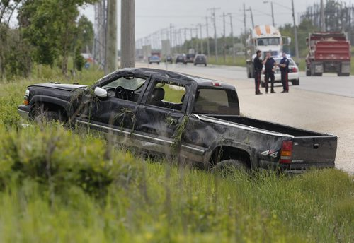 MVC . Single vehicle rollover involving the driver losing control  and being ejected from the pickup truck .The driver was transported to hospital . MVC on Wilkes Ave  at Elmhurst Rd. just after 1pm  .    June 23 2014 / KEN GIGLIOTTI / WINNIPEG FREE PRESS