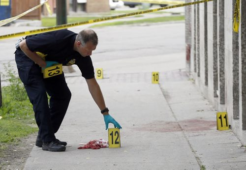 Police investigators place evidence markers along Kennedy S. , the incident began at Cumberland  and Kennedy St progressing south  to ending at 461 Kennedy . Wpg Police investigate a crime scene  on Cumberland Ave . between at Balmoral St.  ans Edmonton ST. , three women were stabbed , all are in stable . June 27 2014 / KEN GIGLIOTTI / WINNIPEG FREE PRESS