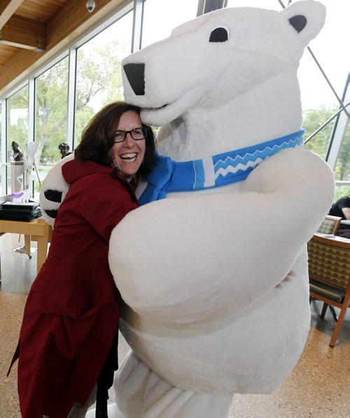 Stdup Zoo Mascot unveiled to the public . The Assiniboine Park Conservancy  , Journey to Churchill 's new mascot Winston made his first public appearance at the Qualico Family Centre just before noon Monday.  Assiniboine Park Conservency President and CEO Margaret Redmond get hug from Winston. The JtoC  is set to open Thurday  June 30 2014 / KEN GIGLIOTTI / WINNIPEG FREE PRESS