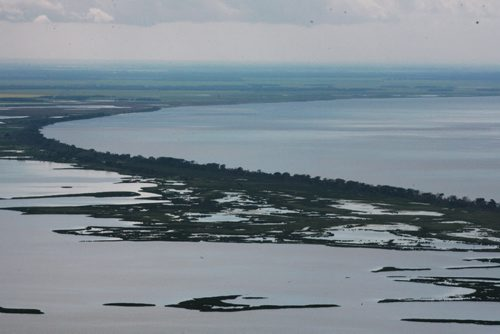 Heavy rains in western Manitoba and Saskatchewan recently have raised the level of the Assiniboine River causing it to overflow its banks flooding roads and farmers fields.   Aerial photo's of the south basin of Lake Manitoba area.  July 08, 2014 Ruth Bonneville / Winnipeg Free Press