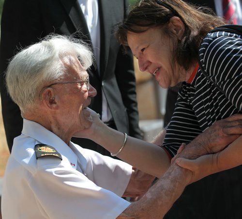 George Peterson, the last surviving member of the group of seven local Arden Ave war veterans from the Battle of Hong Kong, is congratulated by a longtime friend Diane Peterson (not related)  as he sits in one of the 7 chairs of honour  at the new Jules Mager Park in St. Vital where a special ribbon cutting ceremony was held Saturday morning. Minister Kevin Chief and St. Vital Councillor Brian Brian Mayes help Mr. Peterson out of his wheelchair and onto one of the seven chairs. See Ashley Prest story. July 12, 2014 Ruth Bonneville / Winnipeg Free Press