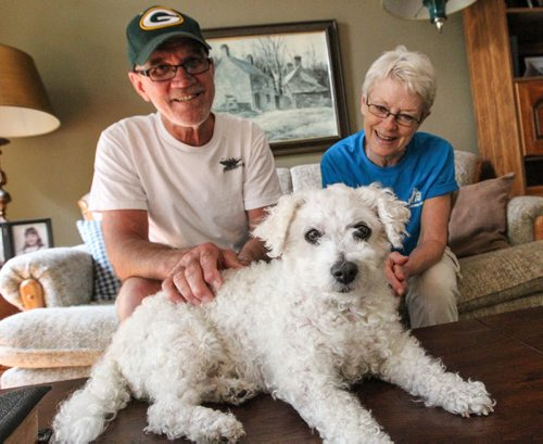 """Ron (left) and Penny Maletic and their 10-year-old Bichon Frise """"Teddy."""" Teddy was overweight and suffered his entire life with severe allergies, but has got a new lease on life since Penny started cooking his pet food at home four months ago. 140717 - Thursday, July 17, 2014 -  (MIKE DEAL / WINNIPEG FREE PRESS)"""