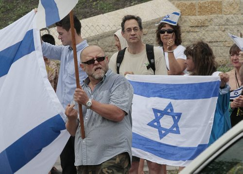 July 21, 2014 - 140721  -  An Israel supporter gestures to Palestinian supporters as about 100 Israel supporters gather for a rally in downtown Winnipeg Monday, July 21, 2014. John Woods / Winnipeg Free Press