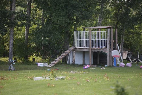 Peguis First Nation –  A play structure and childrens toys on the grounds where a small trailer sits on Peguis First Nation that community members identified as the home where RCMP are investigating a homicide of a 21 month old girl- Police began investigating last Thursday and today released that they are investigating the childs death as a possible homicide-See Alex Paul story- July 23, 2014   (JOE BRYKSA / WINNIPEG FREE PRESS)