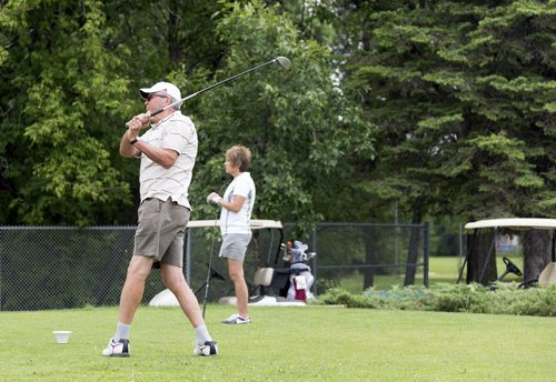 Gerry Askew tees off at Kildonan Park Golf Course on Friday. Mayoral candidate Gord Steeves has pledged to sell off four city-owned golf courses to raise $100 million for road renewal. Sarah Taylor / Winnipeg Free Press *City story on golf courses for roads.