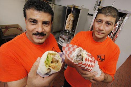 July 28, 2014 - 140728  -  Samy Ebrahim (L) and Tahsin Adel owners of Best Pizza and Donair with a Lamb Kabob Sandwich (L) and Donair in a Pita in Winnipeg Monday, July 28, 2014.  John Woods / Winnipeg Free Press