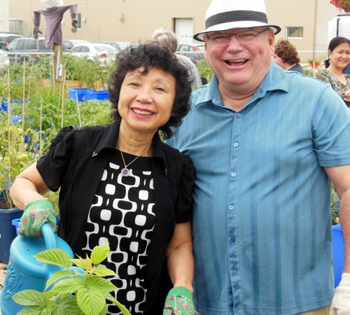 JOHN JOHNSTON / WINNIPEG FREE PRESS  Social Page for August 2nd, 2014  Community Gardening –Winnipeg Harvest Emterra Donation  Emterra founder and CEO Emmie Leung with Deputy Mayor and St. Charles City Councillor Grant Nordman.