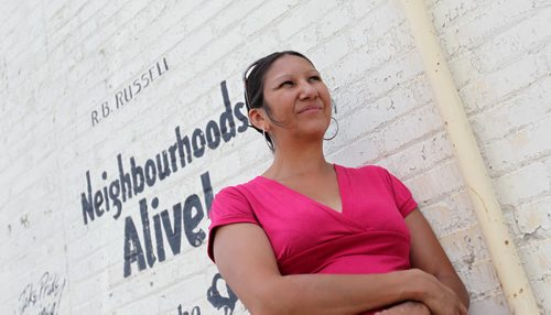Althea Guiboche, also known as the Bannock Lady, stands near the corner where she hands out free bannock  weekly (Dufferin & Main) with her children after talking to the media about her views on the recent Facebook posting scandal.   See story.   Aug 09, 2014 Ruth Bonneville / Winnipeg Free Press